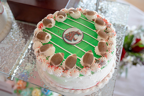 Cake with football themed decorations.